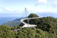 Curved Suspension Bridge. For pedestrians on Gunung (Mount) Mat Cincang, Langkawi Island, Malaysia. This suspension bridge was the winner of a prestigious Swiss Royalty Free Stock Photography