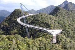 Curved Suspension Bridge. For pedestrians on Gunung (Mount) Mat Cincang, Langkawi Island, Malaysia. This suspension bridge was the winner of a prestigious Swiss Stock Photography