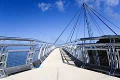 Curved Suspension Bridge Royalty Free Stock Images