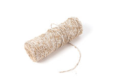 Curved thick string and a roll on white Stock Images