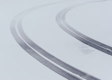 Curved tire tread marks Royalty Free Stock Photo