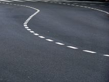 Free Curved Traffic Marks On Asphalt Stock Images - 5483264