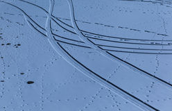 The curved trails and dots on the snow Stock Photos