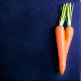 Curved twisted roots of carrot Stock Images