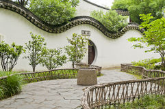 A curved wall. A curved white wall in chinese traditional garden stock image