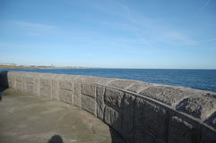 Curved wall end of tynemouth pier Royalty Free Stock Images