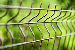 Curved welded steel fence closeup Royalty Free Stock Photography