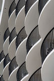 Curved white hotel balconies. With black iron railings royalty free stock photo