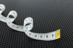 Curved white measuring tape Stock Photos