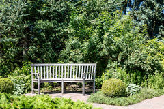 Curved Wood Bench on Walkway in Park Royalty Free Stock Images
