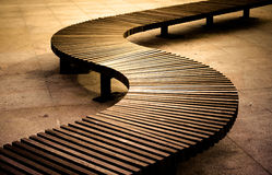Curved wooden boarded bench Stock Images