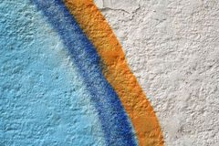 Curves. Graffiti curves in orange and blue on a white wall Stock Photography