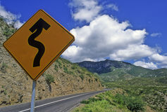 Curves ahead. Yellow sign in a road, sierra gorda of Queretaro in Mexico royalty free stock photography