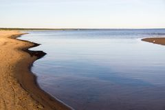 Curves of coastline in summer morning Royalty Free Stock Photos