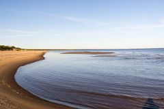 Curves of coastline in summer morning Stock Images
