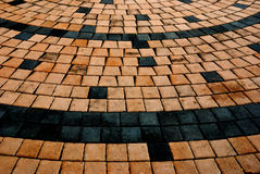Curves on the floor made with  bricks Stock Image