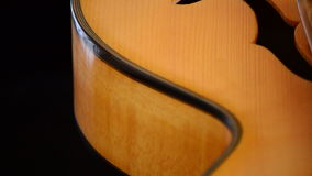 Curves of jazz electric guitar, detail. Classic Electric Guitar Jazz Rotating in Horizontal stock footage