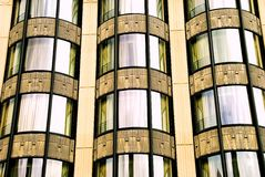 Curves and reflections. A renovated art-deco building in San Diego's historic Gaslamp Quarter, with reflections and curves royalty free stock photos