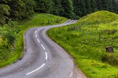 Curves on road in Scottish countryside Stock Images