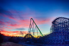 Curves of a roller Coaster atSunset or sunrise. Curves of a roller Coaster at Sunset or sunrise Royalty Free Stock Image