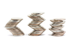 Curvilinear laid stacks of coins Stock Images