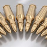 Curved Line of Gold Bullets on White. Curving array of gold rifle bullets on a reflective surface. This image is a 3d rendering Stock Photo