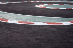 Curving asphalt red and white kerb of a race track detail. Motorsports racing circuit Race track curve road for car racing royalty free stock photos
