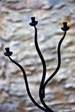 Curving cast iron candle holder Royalty Free Stock Photos