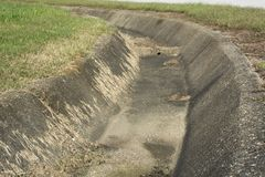 Concrete drainage ditch royalty free stock photos