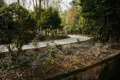 Curving countryside path by irrigation ditch in sunny winter aft. Ernoon,Chengdu,China royalty free stock images