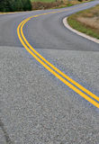 Curving county road in rural area Stock Photo
