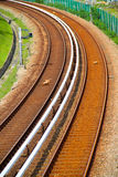 Curving electric train track. Railway track of electric train royalty free stock images