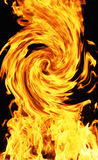 Curving fire. Curving and  whirling  orange blazing fire on black background Royalty Free Stock Photography