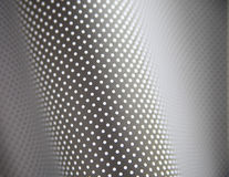 Curving gray and white polka dot background Stock Photography