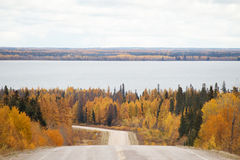 A curving highway down to a lake Royalty Free Stock Images