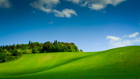 Curving hill under blue sky Royalty Free Stock Photo
