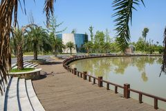 Curving lakeside path,stairway and tarred road in sunny summer a. Fternoon,Chengdu,China stock images