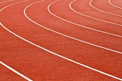 Curving lanes of a red race track. In stadium royalty free stock images