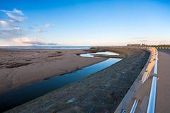 Curving Metal Railings At A Beach Edge Royalty Free Stock Photo