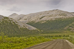 Curving muddy Dempster Highway Stock Photos
