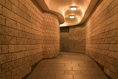 A curving pedestrian tunnel (subway) in the City of London, at night Royalty Free Stock Photography
