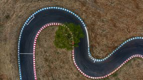 Curving race track view from above, Aerial view car race asphalt track and curve.  royalty free stock photos