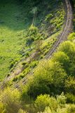 Curving Railway Track through a Forest Stock Photo