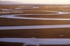Curving River. The curving river is Ba Yin Bu Lu Ke prairie in Xinjiang China royalty free stock image