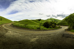 Curving Road in Livermore California. Curving u-turn road in Livermore California on a cloudy day royalty free stock photos