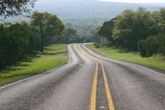 Curving road in the Texas Hill Country. A curving highway in the Texas Hill Country stock photos