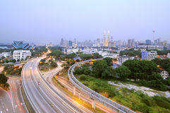 Curving Road Towards Kuala Lumpur. Image of curving road towards Petronas Twin Tower from Pekeliling apartment in Kuala Lumpur, Malaysia Royalty Free Stock Image