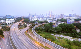 Curving Road Towards Kuala Lumpur. Image of curving road towards Petronas Twin Tower from Pekeliling apartment in Kuala Lumpur, Malaysia Royalty Free Stock Images