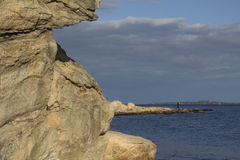 Curving shoreline with boulders and gravel along the Connecticut. Royalty Free Stock Photo