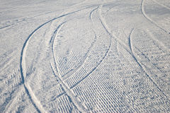 Curving ski track in snow. Low angle view of curving ski tracks on snow covered slope stock photography